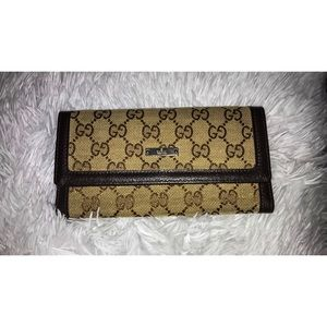 Gucci Monogram Flap Wallet